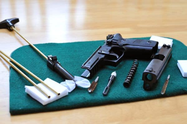Disassembled Pistol On Table