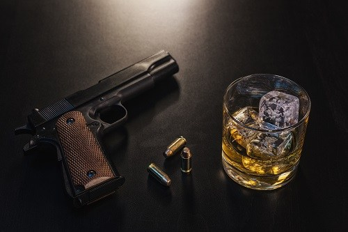 Handgun And Glass Of Whiskey