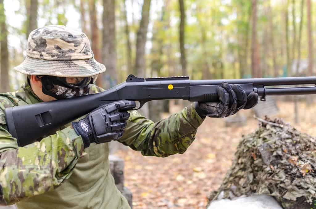 soldier in camouflage shooting hunting rifle