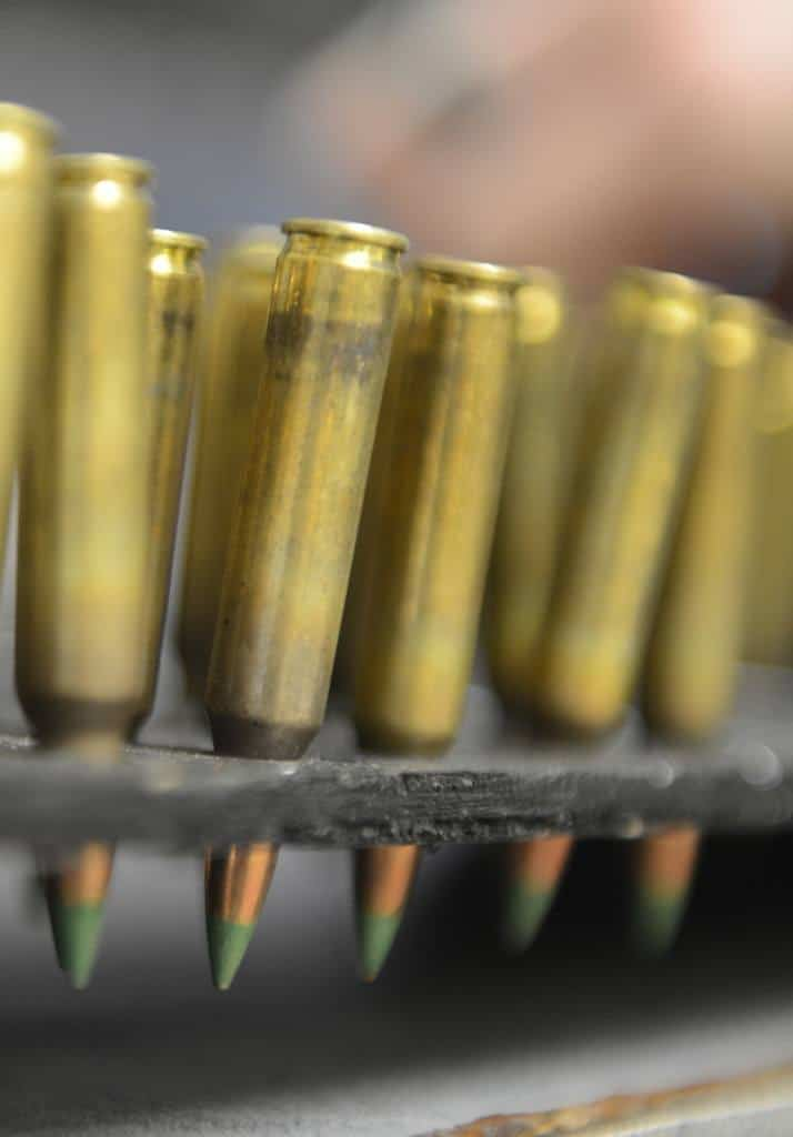 A row of gold bullets in a cartridge