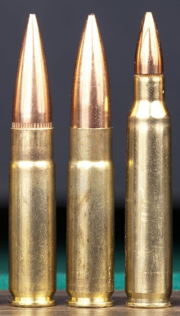 Photo of some bullets and ammo standing upright