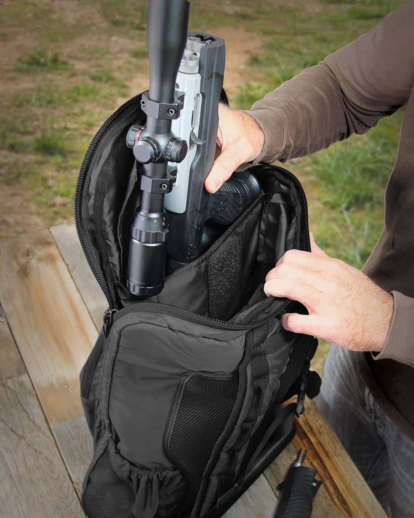 Inserting a gun into a bag