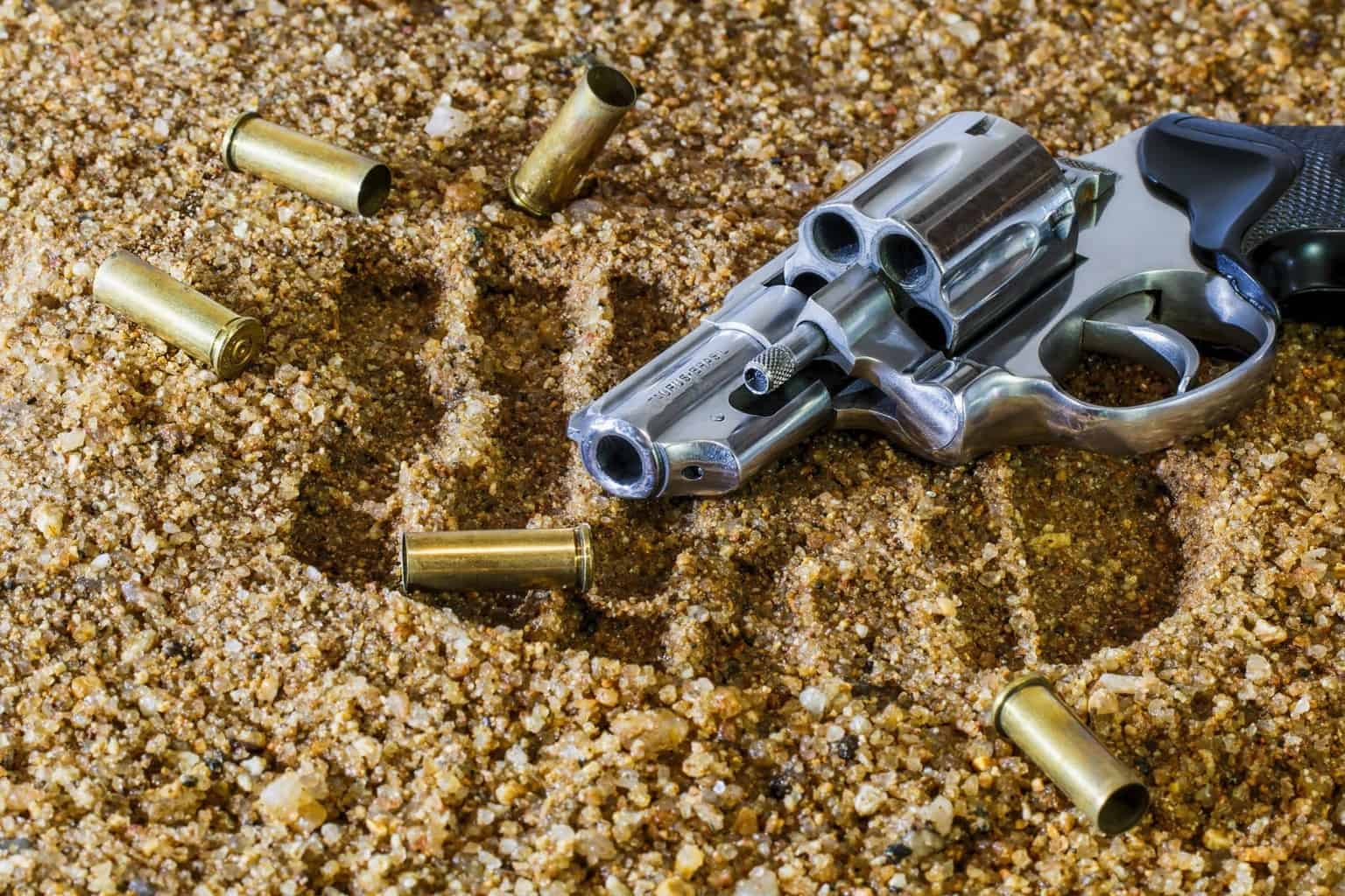 A photo of a gun on the ground surrounded by used bullets at one of the best gun ranges in Ohio