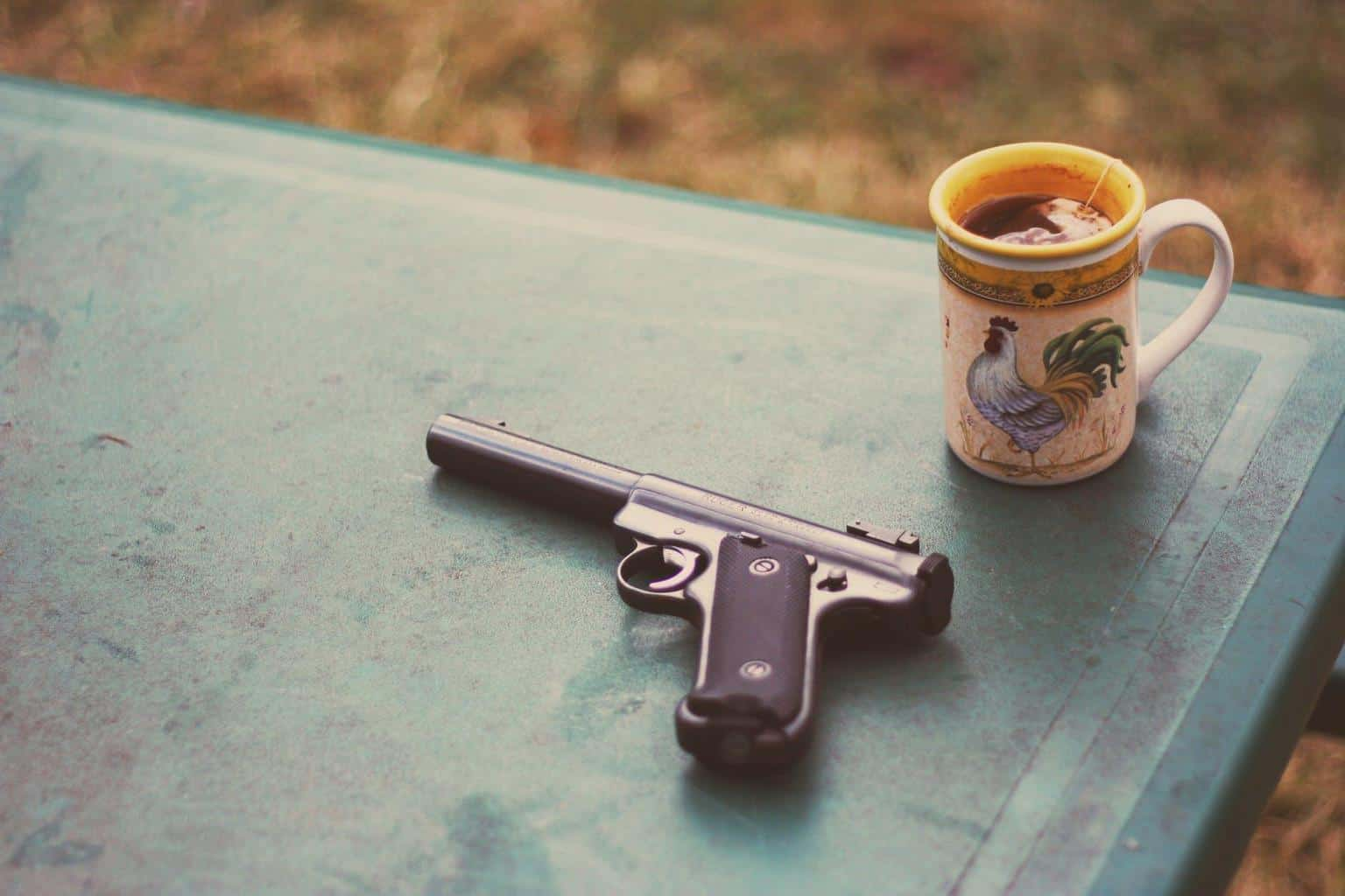 A photo of a gun and a coffee mug at a top shooting range in Pennsylvania