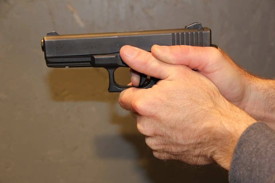Man pointing a handgun