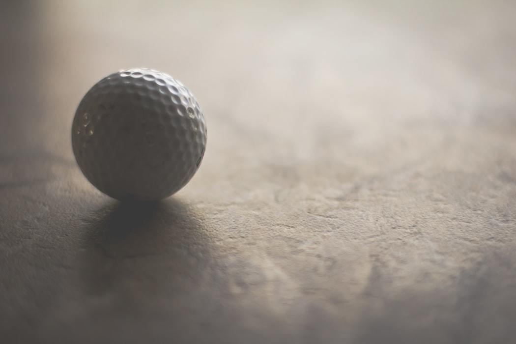 Golf ball on white surface