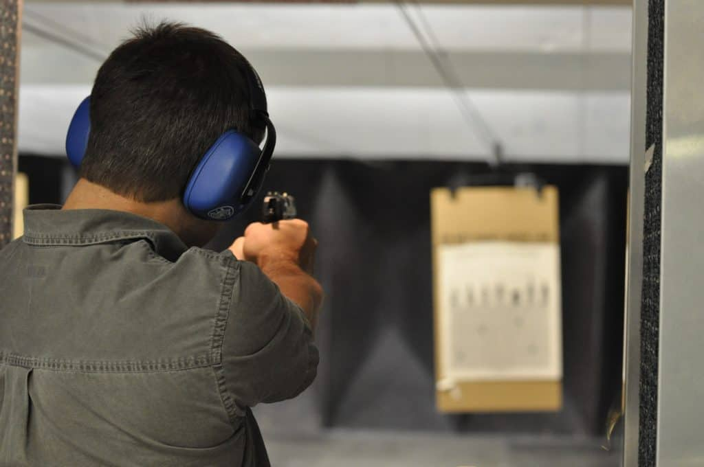 Man practicing shooting at a gun range