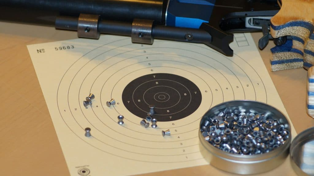 Air pistol pellets and a target paper board