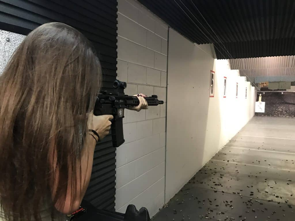 Woman aiming her rifle at a gun range in Maine