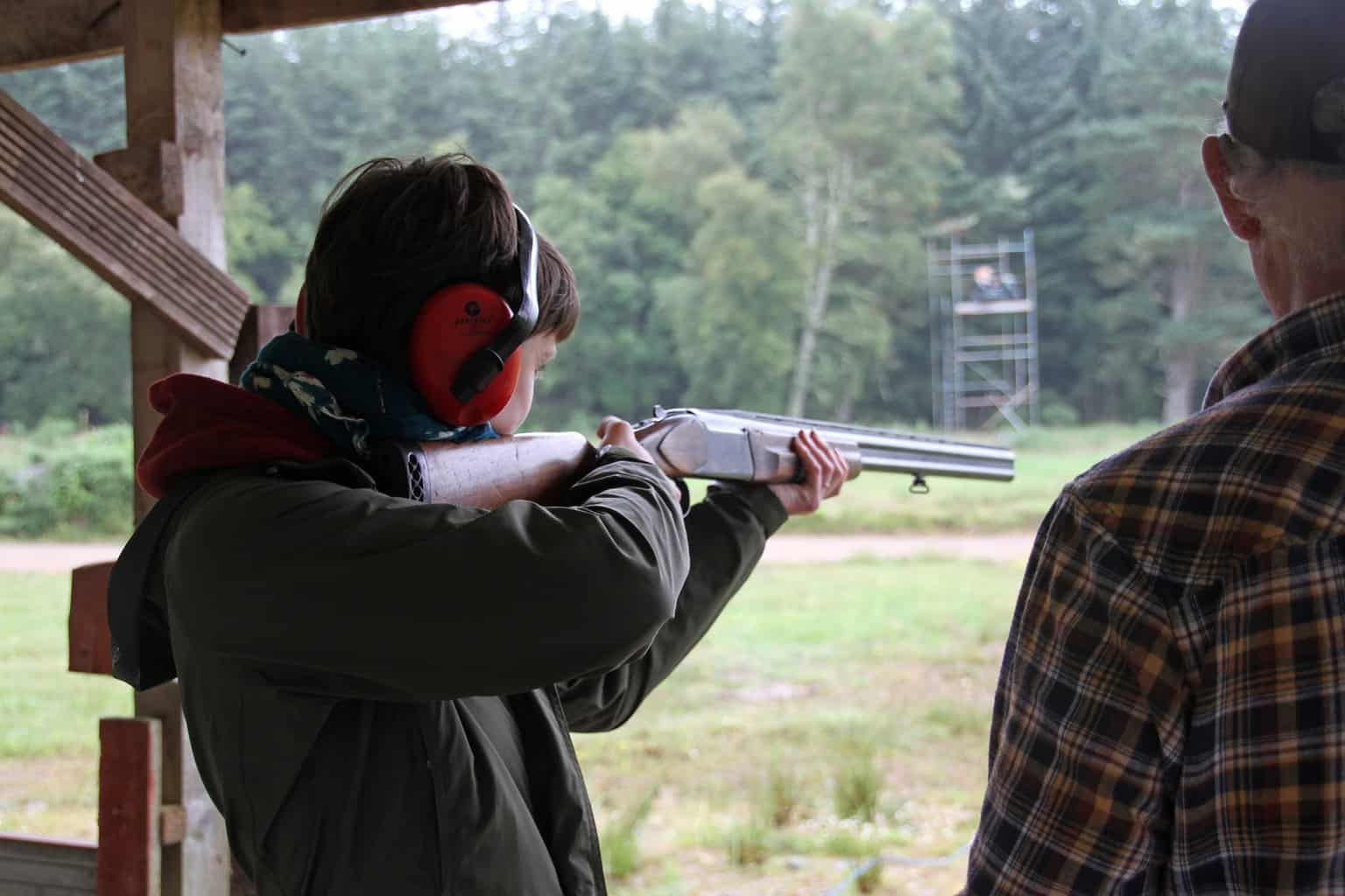 Teenager shooting with a rifle at a gun range in Massachusetts