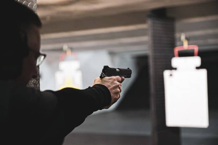 Man doing practice shooting in a North Carolina gun range