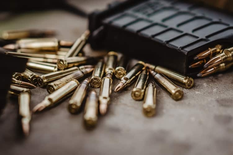 Dozens of ammunition scattered on a table