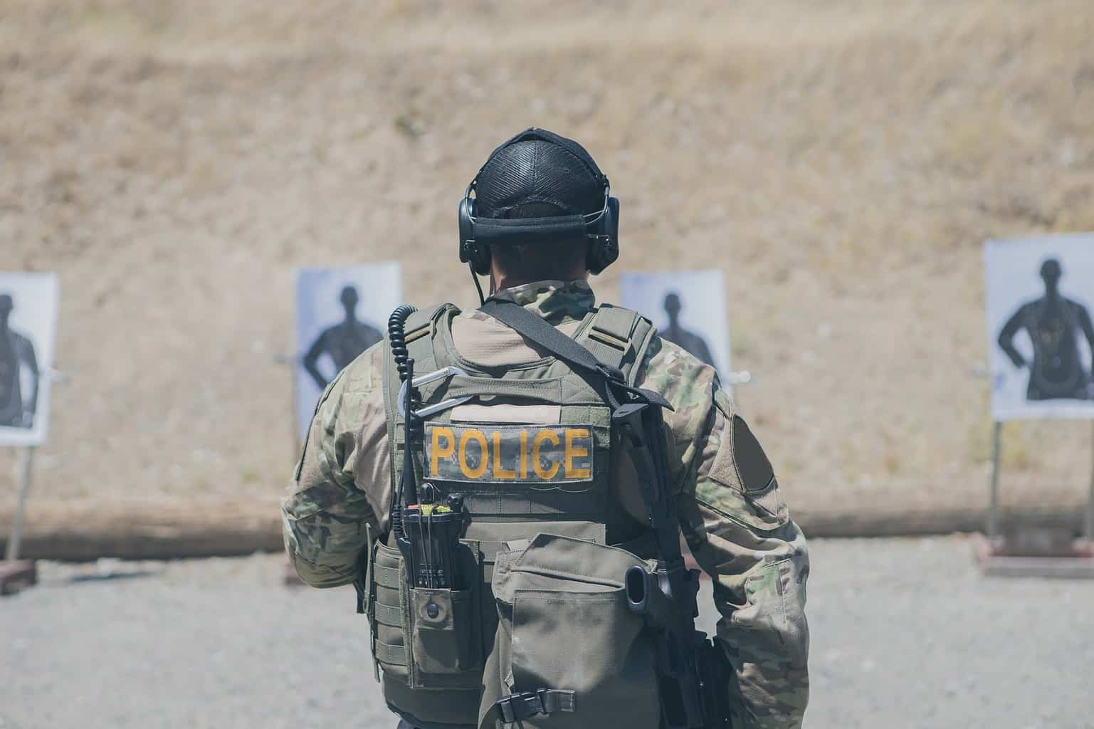 Man wearing uniform at an outdoor shooting range in California