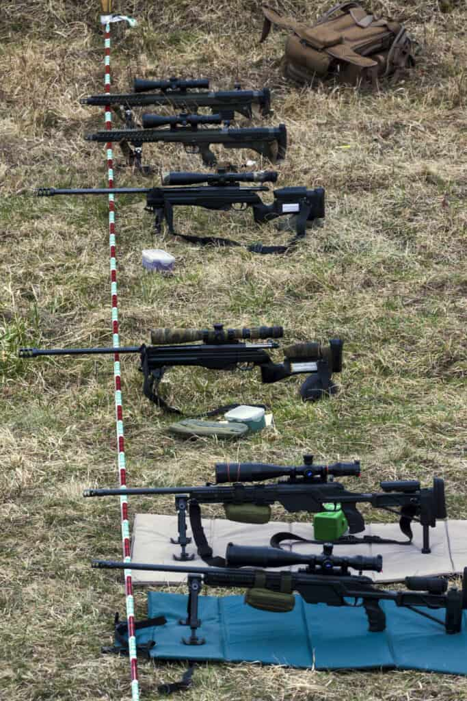 Military rifles aims at a target
