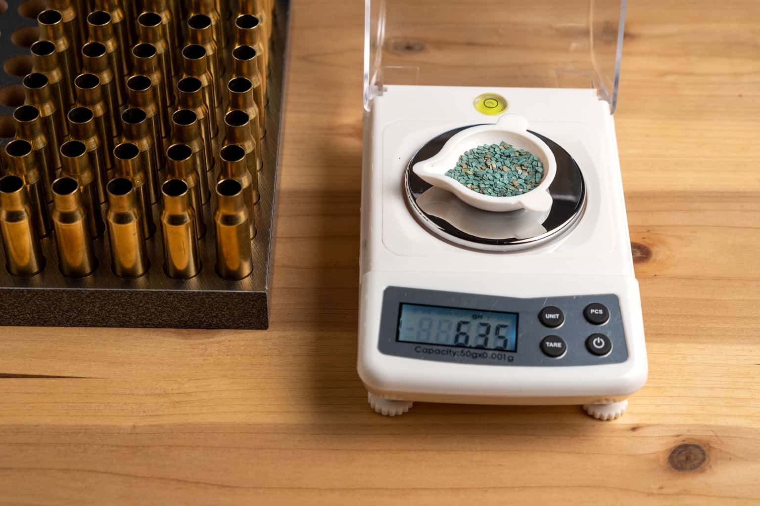 Gunpowder scales being weighed on a reloading scale