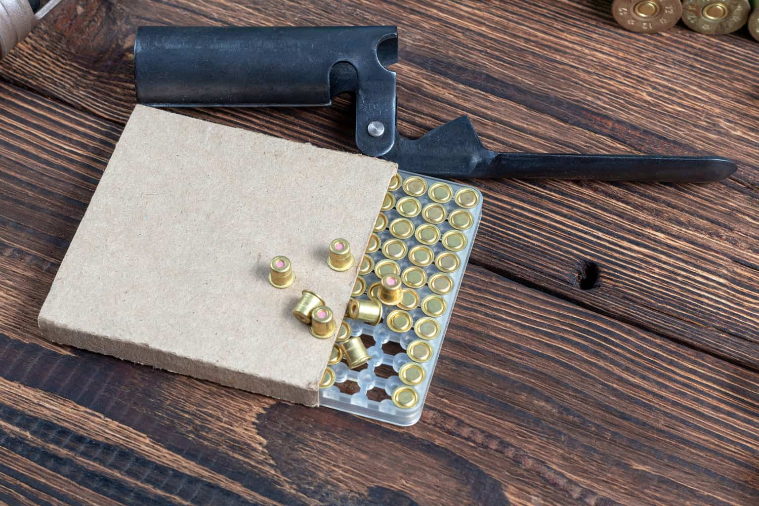 Hand priming tool with a box of shotgun shells