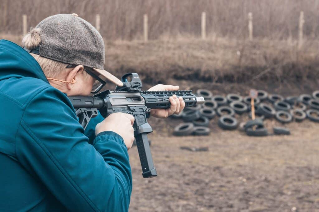 Man sighting an AR 15 and testing if a .233 can kill a bear
