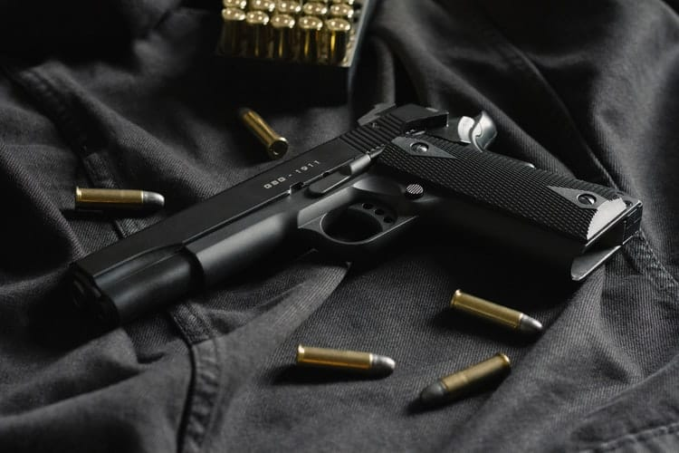 Handgun with bullets surrounding it