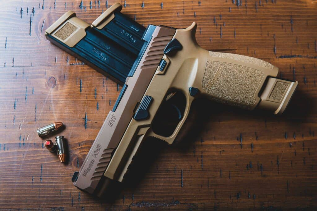 Brown and copper semi automatic pistol with bullets