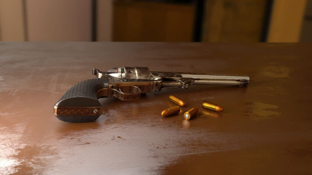 Handgun and bullets on a table