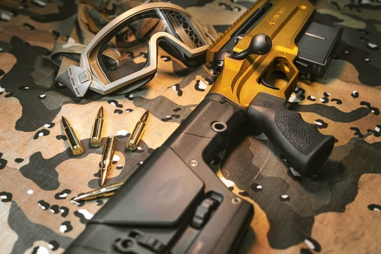 Rifle and gun accessories being laid on the table