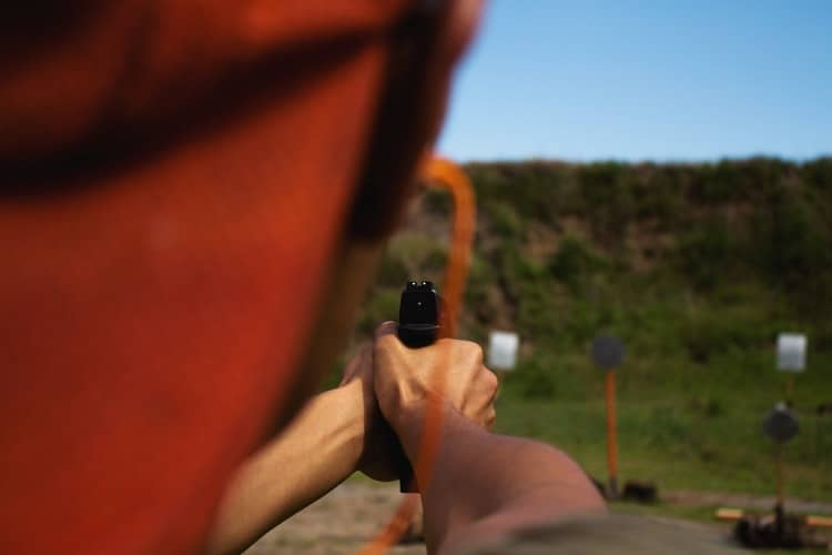 Person aiming at a target in a shooting range in Utah