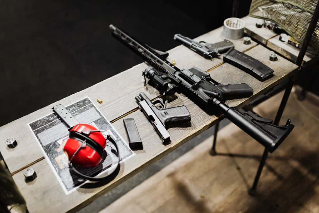 Rifle and gun accessories in a table