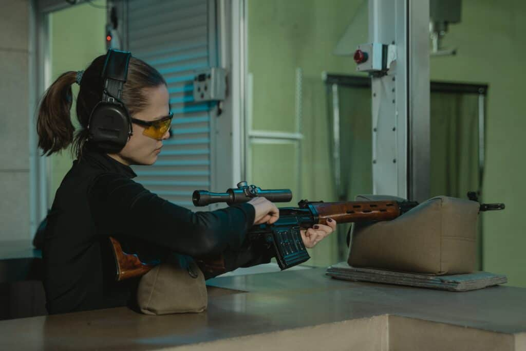 Woman reloading a rifle