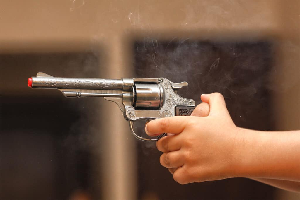 Person holding a handgun that was just fired
