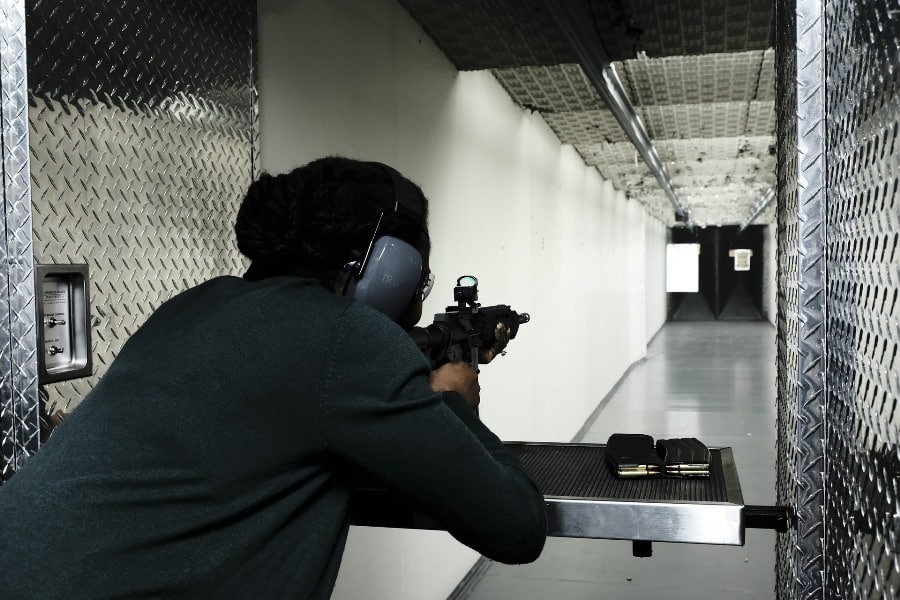 Man aiming at a target not needing a gun permit to shoot at a gun range in Ohio
