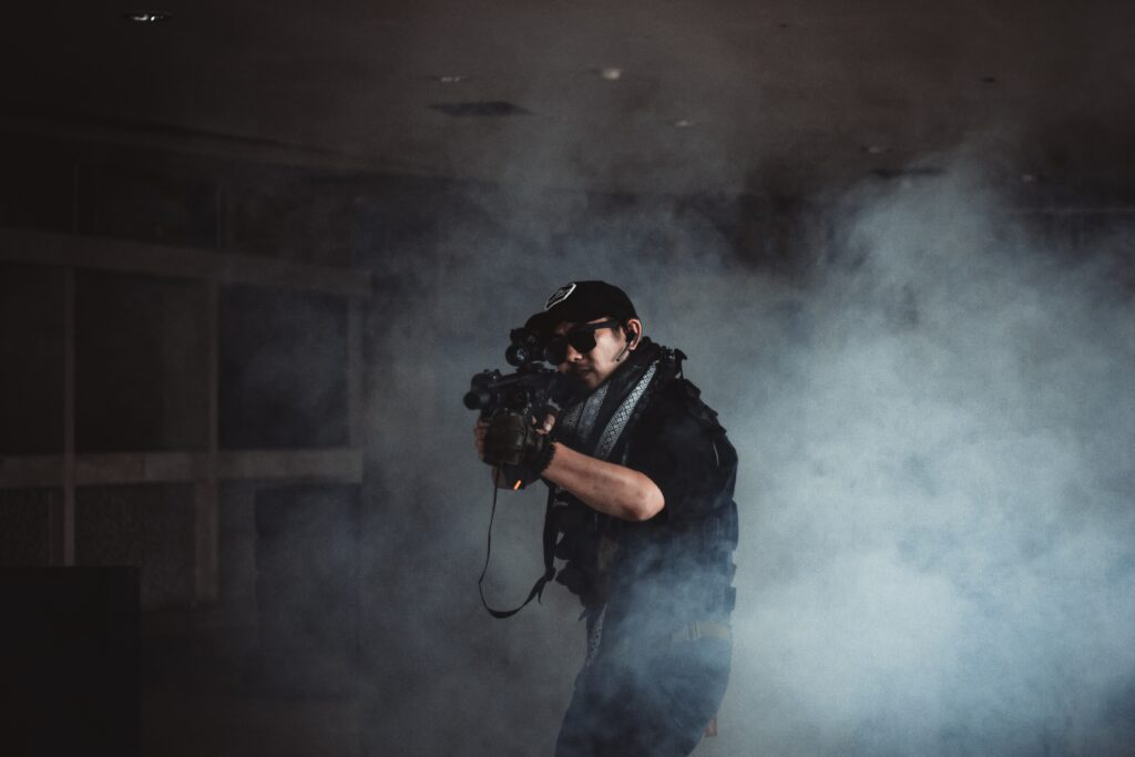 man aiming with a firearm in smoke