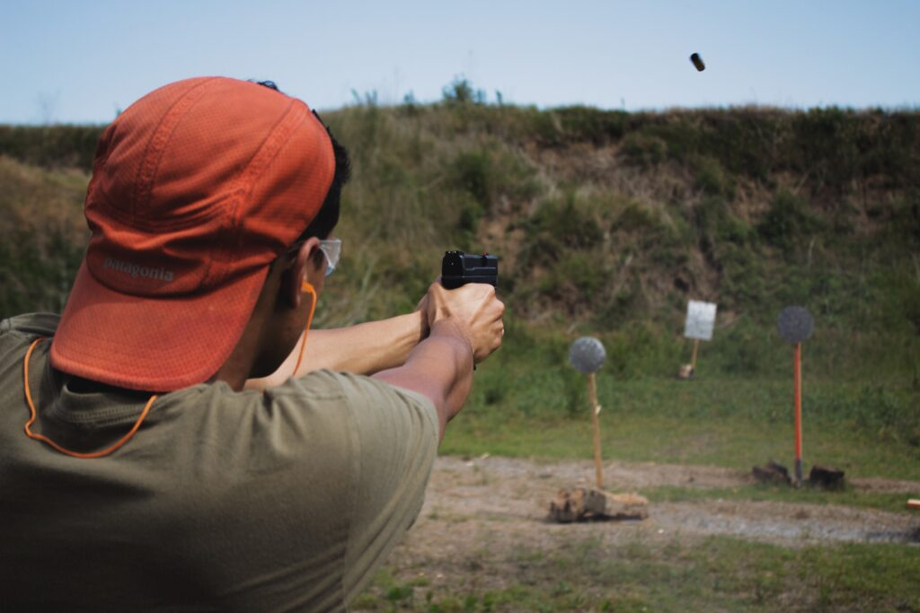 A guy shooting a target paper at a distance