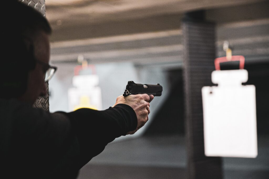 A guy doing a practice shooting with a pistol