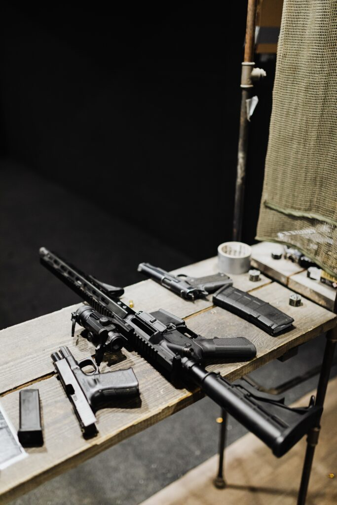 Different kinds of guns on a table
