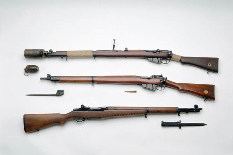 Three rifles lined up on a table