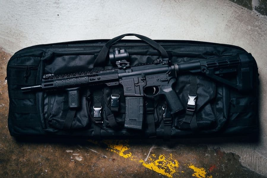 Rifle on top of a soft case