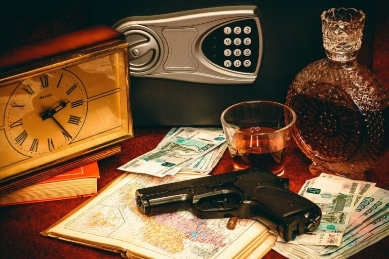 Gun on top of a pile of a map, paper bills and near a gun safe and clock